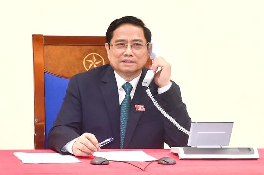 Tân Thủ tướng Phạm Minh Chính điện đàm với Thủ tướng Lào, Campuchia - Ảnh 1.