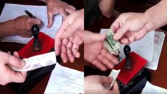 Trưởng Công an xã bị đình chỉ để làm rõ trách nhiệm thu sai lệ phí làm căn cước gắn chip - Ảnh 1.