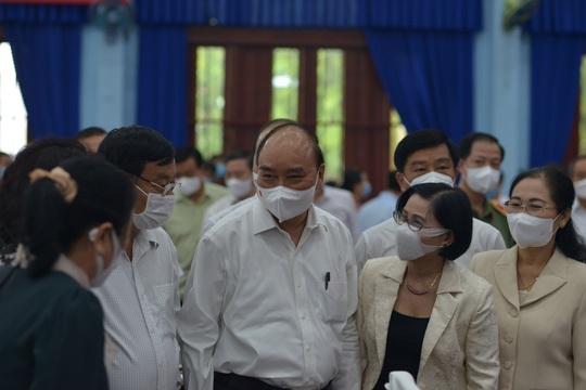 Chủ tịch nước Nguyễn Xuân Phúc ủng hộ đề xuất tăng tỉ lệ ngân sách để lại cho TP HCM - Ảnh 1.