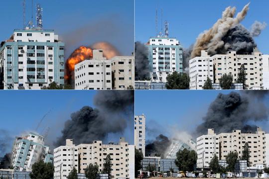 Một giờ tháo chạy trước khi Israel đánh sập tòa nhà truyền thông ở Gaza - Ảnh 1.
