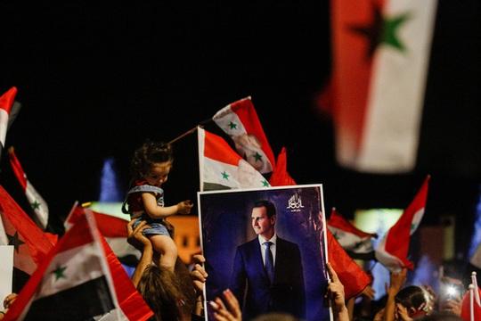 Tổng thống Syria tái đắc cử với số phiếu áp đảo - Ảnh 1.