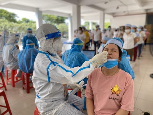 300.000 người lao động bị cách ly y tế sẽ được hỗ trợ - Ảnh 1.