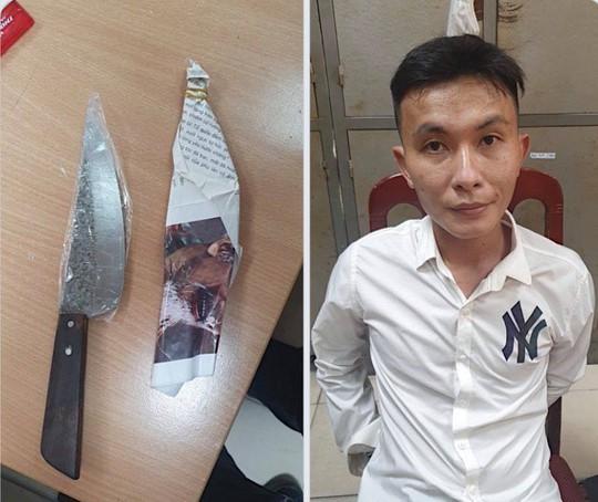 Cầm dao chọc tiết lợn xông vào cửa hàng cướp 3 chiếc áo và chân váy tặng bạn gái - Ảnh 1.