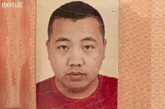 Công an TP HCM truy nã một người Trung Quốc - Ảnh 1.