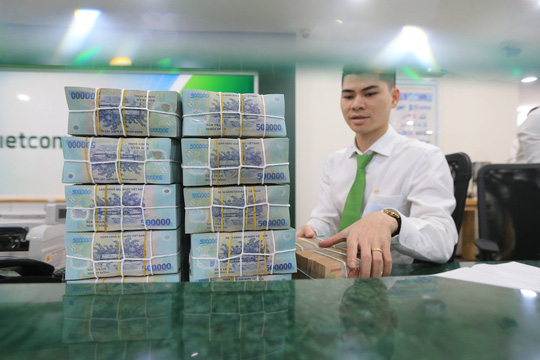 Ngân hàng thừa tiền, doanh nghiệp vẫn đói vốn - Ảnh 1.