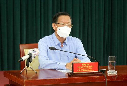 Ông Phan Văn Mãi: TP HCM có thể tiếp tục thực hiện Chỉ thị 16 trong khoảng thời gian nữa - Ảnh 1.