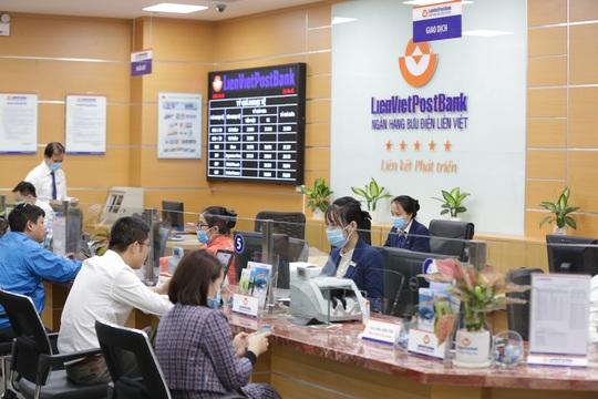 LienVietPostBank báo lãi trước thuế hơn 2.000 tỉ đồng, hoàn thành 2/3 kế hoạch lợi nhuận cả năm - Ảnh 1.
