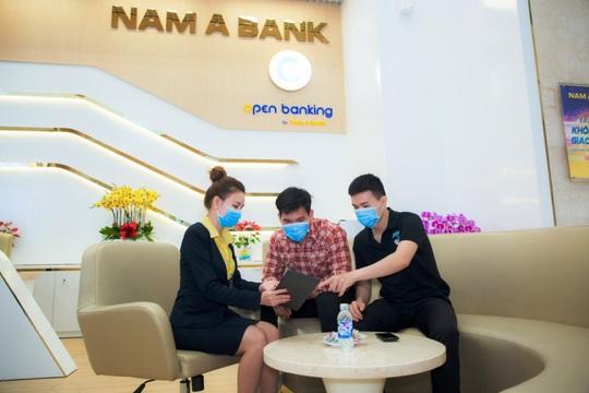 Giao dịch ngân hàng trực tuyến tăng mạnh, góp phần phòng dịch hiệu quả - Ảnh 2.