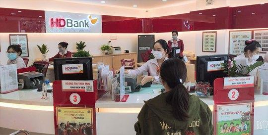 Thêm ngân hàng giảm lãi suất cho vay - Ảnh 1.