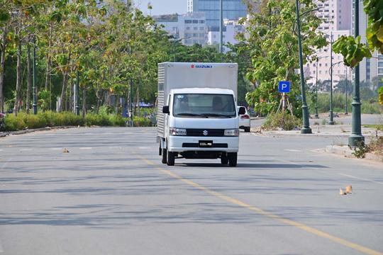 Đáp ứng nhu cầu vận chuyển hàng hoá thiết yếu trong giãn cách với Suzuki Carry Pro - Ảnh 1.