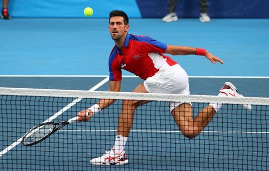 Djokovic lỡ cơ hội giành Golden Slam sau thất bại ở Olympic Tokyo 2020 - Ảnh 1.