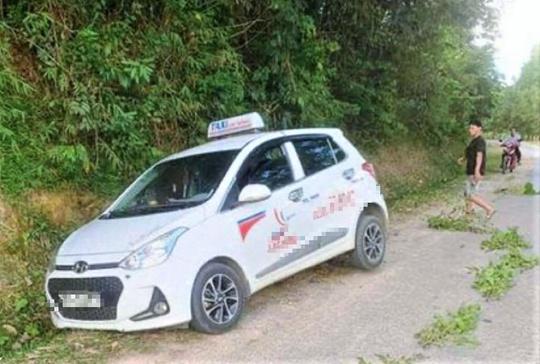 Vụ tài xế taxi bị cắt cổ tử vong: Nghi phạm là chủ tiệm sửa xe máy - Ảnh 2.