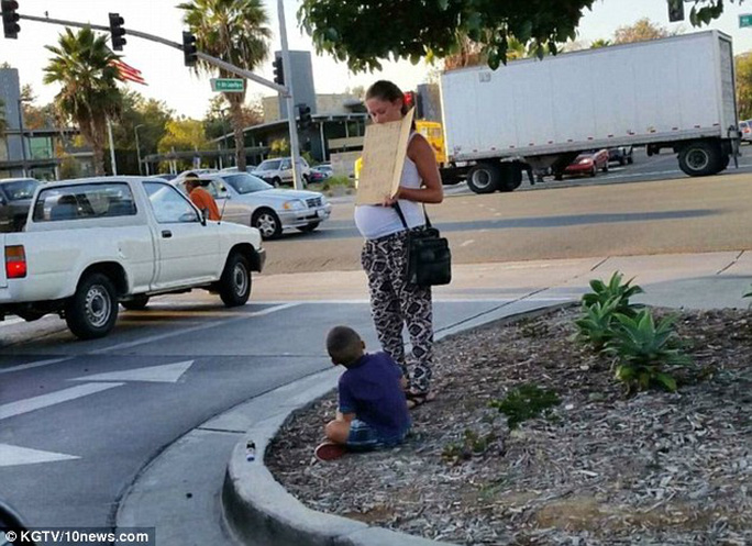 Begging: Shopper Melissa Smith, from San Diego, California, had witnessed this expectant mother and her child begging for money outside the citys Eastlake Village Center every weekend for the past two weeks