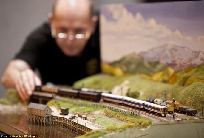 Pint sized model: The handcrafted miniature creations - including this detailed model of a train - were among thousands to be displayed at the National Exhibition Centre