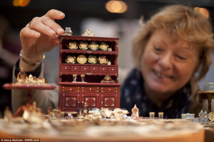 Miniature masterpiece: The tiny creations - including this dresser - were displayed by more than 200 international exhibitors at the show, which was established in 1983