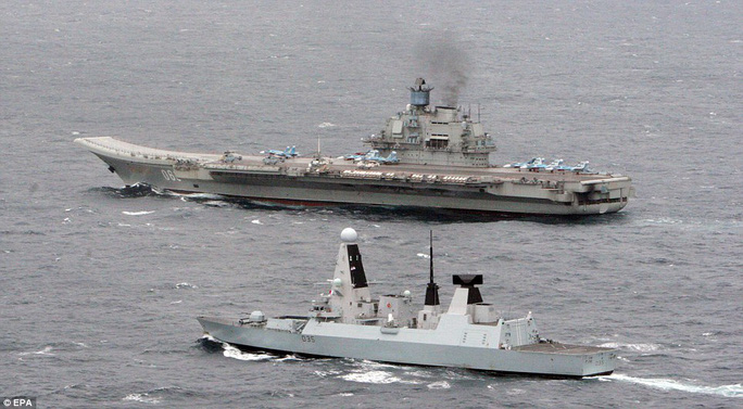 Escort: HMS Dragon (foreground) with the Russian aircraft carrier 'Admiral Kuznetsov', in the English Channel. HMS Dragon tracked and met up with a Russian task group off the coast of Brest as they entered the English Channel yesterday