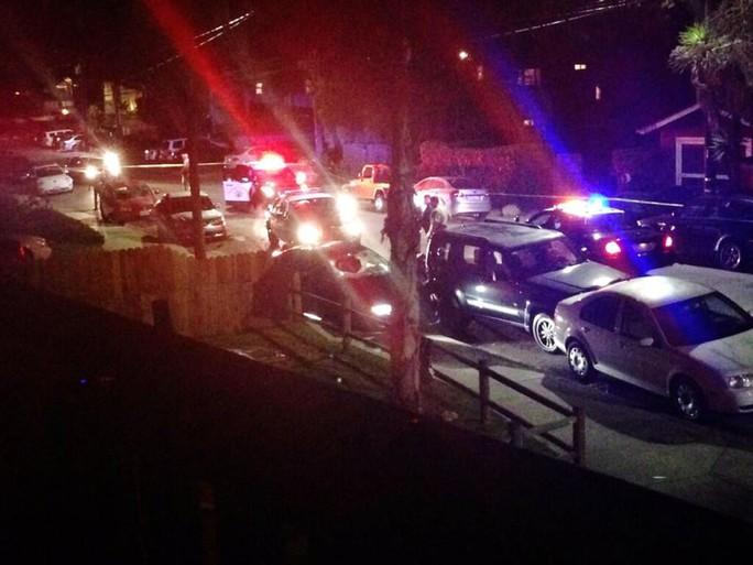 Police surround crashed vehicle in Isla Vista, Calif. following shooting near University of California Santa Barbara.
