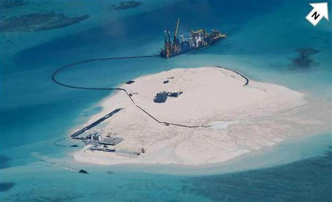 Trung Quốc có hoạt động xây dựng trái phép trên bãi đá Gạc Ma. Ảnh: Reuters