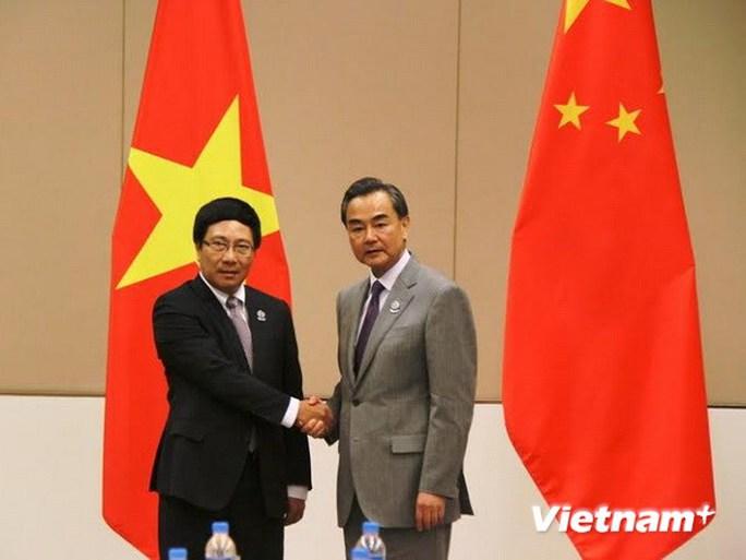 Phó Thủ tướng, Bộ trưởng Ngoại giao Việt Nam Phạm Bình Minh và Bộ trưởng Ngoại giao Trung Quốc Vương Nghị. Ảnh: Việt Hải/Vietnam+