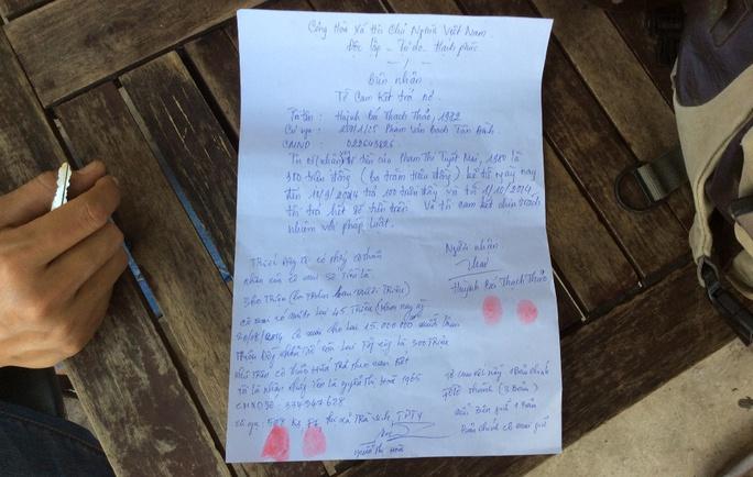 Tờ cam kết bà Thảo viết hứa trả nợ cho chị Mai.