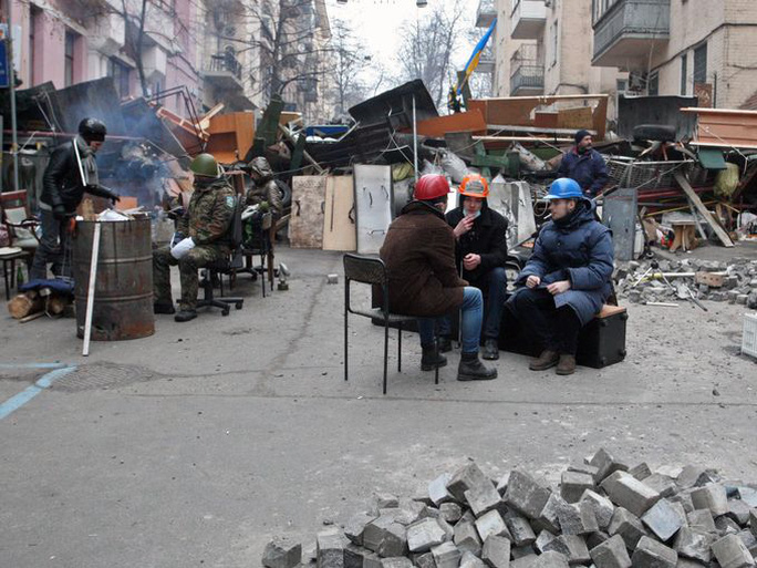 Protesters rest at barricades in Kiev.
