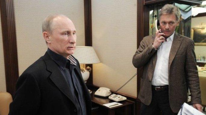 Russian President Vladimir Putin (L) and his press secretary Dmitry Peskov, Interfax Picture