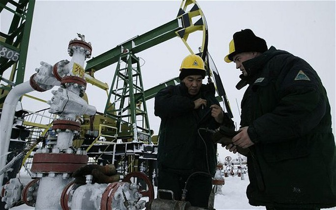 YUKOS workers servicing an oil well on the Ust Balick oil field near Nefteyugansk, West Siberia, Russia