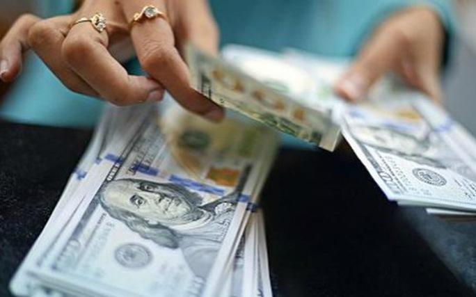 Một số ngân hàng đã chủ động kéo lãi suất cho vay xuống còn 5,5%/năm - Ảnh 1.