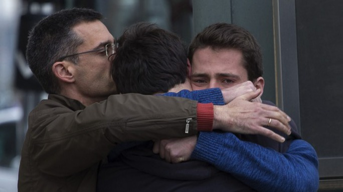 Family members of people involved in the Germanwings plane crash comfort each other as they arrive at Barcelona airport in Spain.