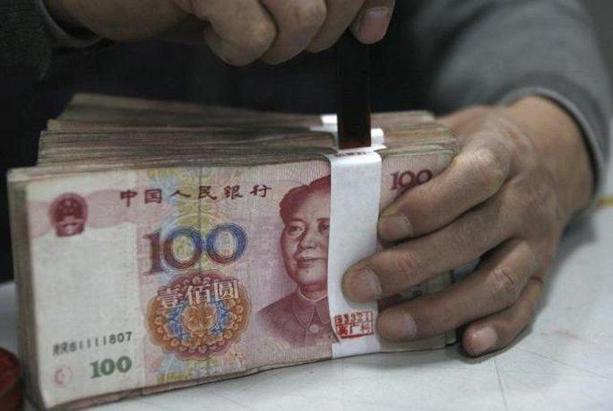 Trung Quốc giảm giá đồng nhân dân tệ để cứu xuất khẩu. Ảnh: Reuters