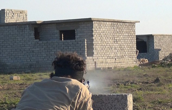Trained: The pictures shows the militants, both bearded and clean-shaven, practising their sniper skills