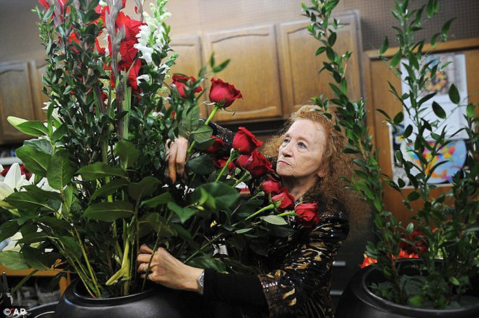Marie Majusiak, owner of Watertown Flowers, works on a one of two flower arrangements  ahead of President Barack Obamas visit