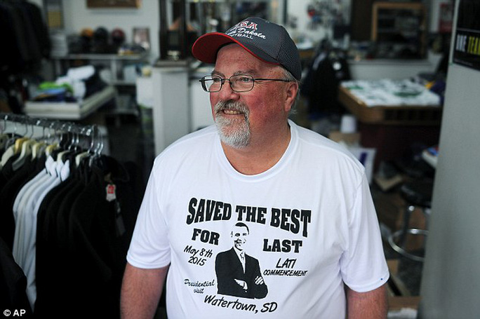 Gary Young, owner of Youngs Primtime Sports, in Watertown, S.D., poses for a portrait in a Saved the Best for Last t-shirt he made for the visit
