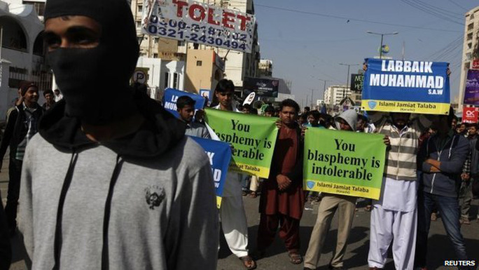 Protesters hold signs and chant slogans during a protest against satirical French weekly Charlie Hebdo in Karachi January 16