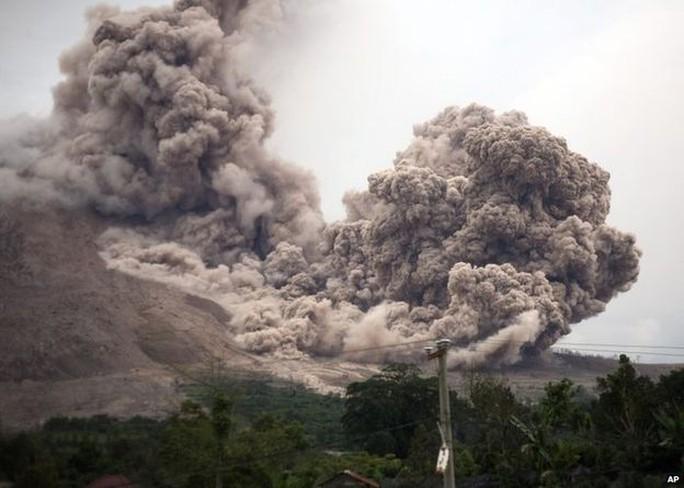 Mount Sinabung releases pyroclastic flows as seen from Tiga Serangkai, North Sumatra, Indonesia, Saturday, June 13, 2015