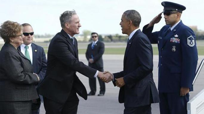 US President Barack Obama (second from right) is greeted by South Dakota Governor Dennis Daugaard (second from left) and his wife Linda Daugaard (left) as he arrives aboard Air Force One at Watertown Regional Airport in Watertown, South Dakota, on May 8, 2015. -- PHOTO: REUTERS