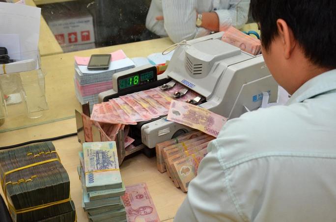 Tính đến ngày 31-3, nợ xấu trên địa bàn TP HCM là hơn 60.800 tỉ đồng Ảnh: Tấn Thạnh