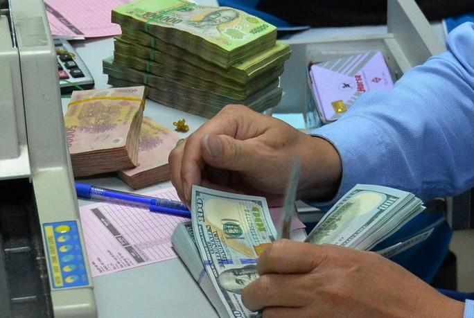 Ngân hàng Nhà nước quyết tâm đưa nợ xấu xuống còn 3% vào cuối năm nay  Ảnh: TẤN THẠNH
