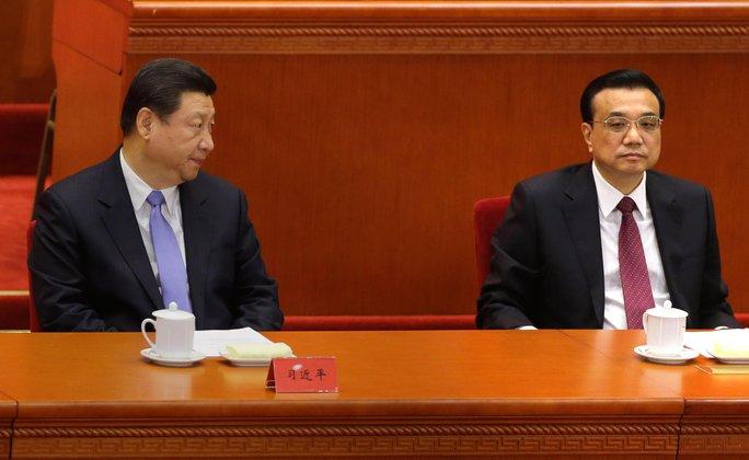 Chủ tịch Tập Cận Bình (trái) và Thủ tướng Lý Khắc Cường (phải) đối mặt nhiều áp lực khi kinh tế Trung Quốc hụt hơi Ảnh: REUTERS