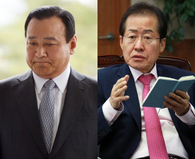 Cựu Thủ tướng Hàn Quốc Lee Wan-koo (trái) và tỉnh trưởng tỉnh Nam Gyeongsang Hong Joon-pyo (phải). Ảnh: Yonhap
