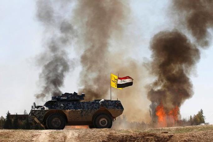 Xung đột diễn ra ác liệt quanh TP Tikrit. Ảnh: Reuters