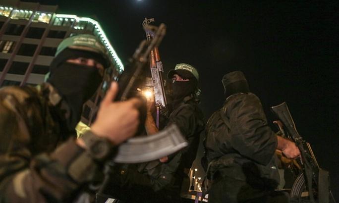 Các tay súng trung thành với Hamas tuần hành ở Gaza. Ảnh: Xinhua