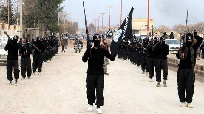 IS vẫn gieo rắc kinh hoàng dù bị liên quân do Mỹ dẫn đầu tấn công. Ảnh: AP