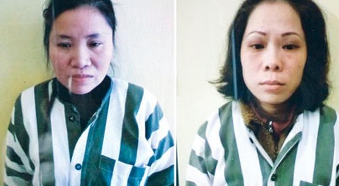 Hai bị can Trang (bên trái) và Nguyệt