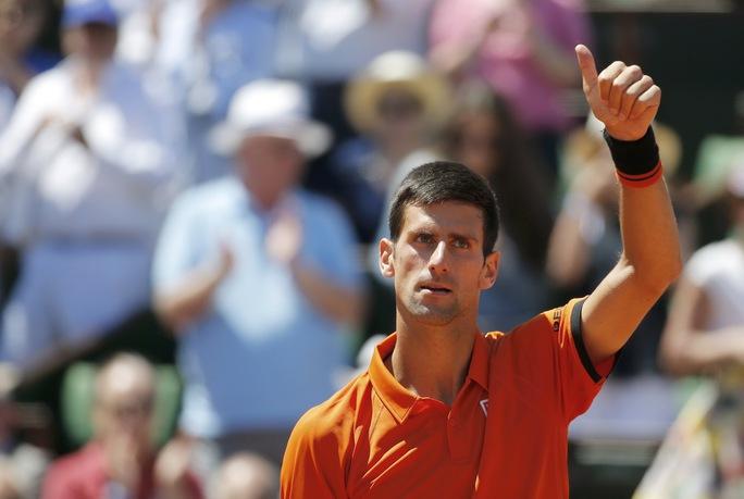 Djokovic đang đứng trước cơ hội lịch sử hoàn tất bộ sưu tập Grand Slam  Ảnh: REUTERS