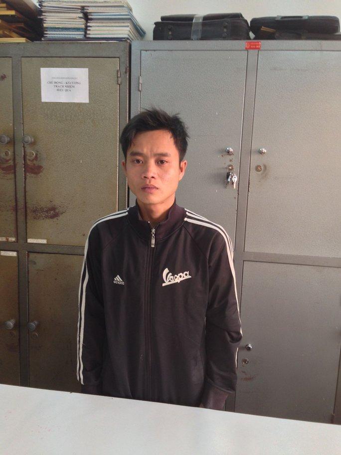 Hung thủ Trương Văn Vĩnh tại cơ quan công an. Ảnh: Á Tam