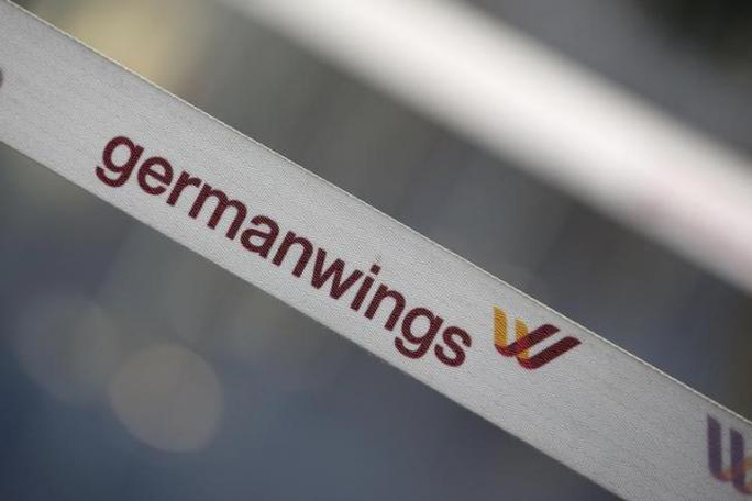 A barrier tape of German airline Lufthansas low-cost carrier Germanwings is pictured at a closed gate of Berlin Tegel airport August 29, 2014. REUTERS/Fabrizio Bensch