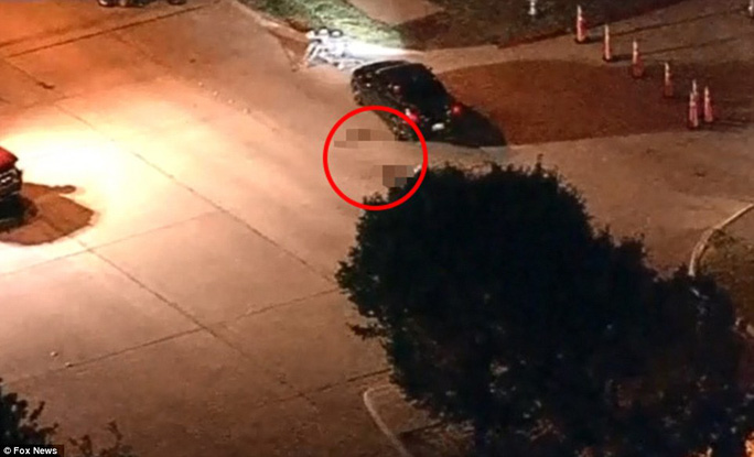 A body was seen lying next to the suspects vehicle as bomb squad robots scoured the area in the aftermath