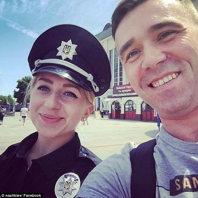 Photogenic police: Attractive new officers have been encouraged to take selfies with members of the public as part of a PR drive to win back trust, and the images have since gone viral