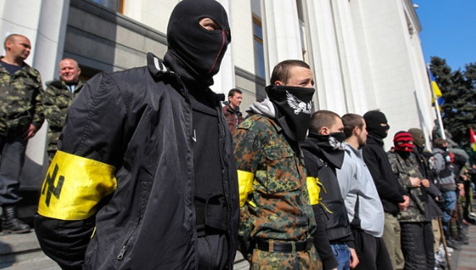 Militants from the Right Sector stand outside Kiev